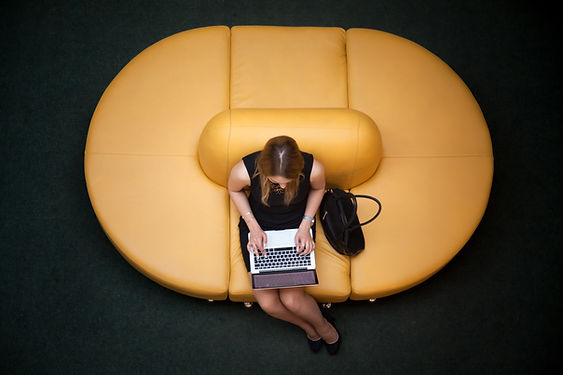young-woman-using-laptop-PGTKYLS.jpg