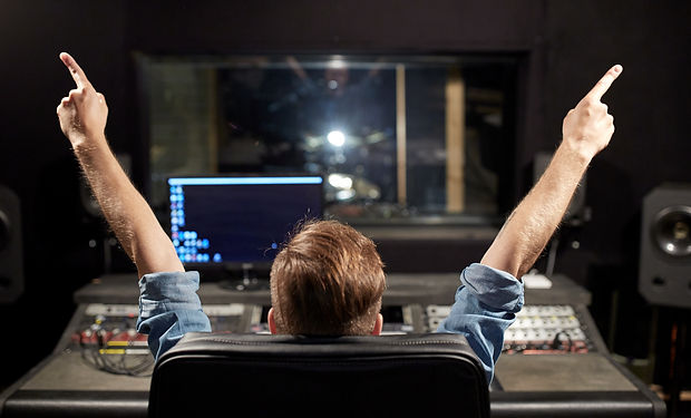 man-at-mixing-console-in-music-recording