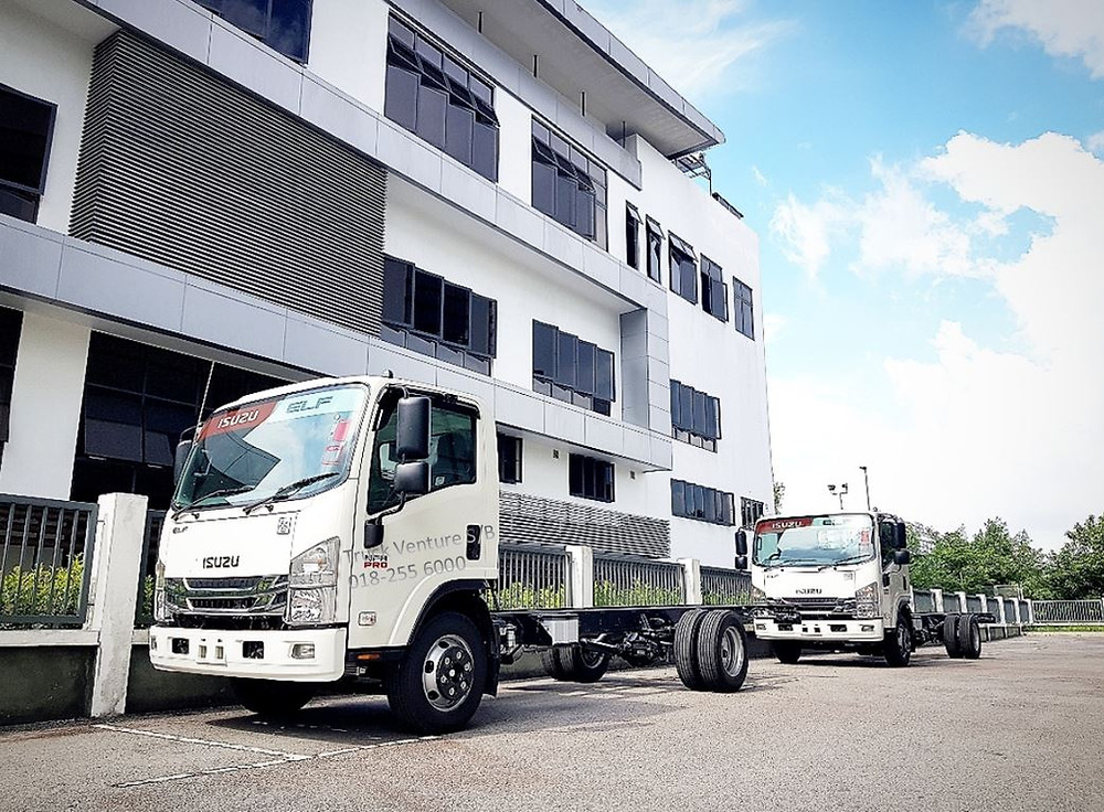 Two New Lorry Chassis Parked and Displayed for Sale at Showroom