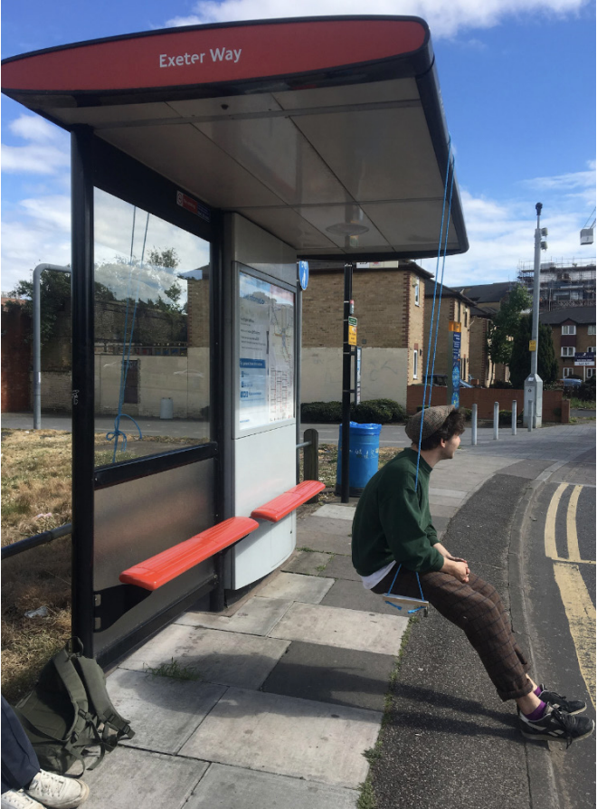 Bus stop swing