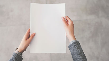 Canva - Person holding white empty paper
