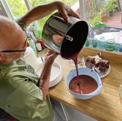 Leon pouring chocolate