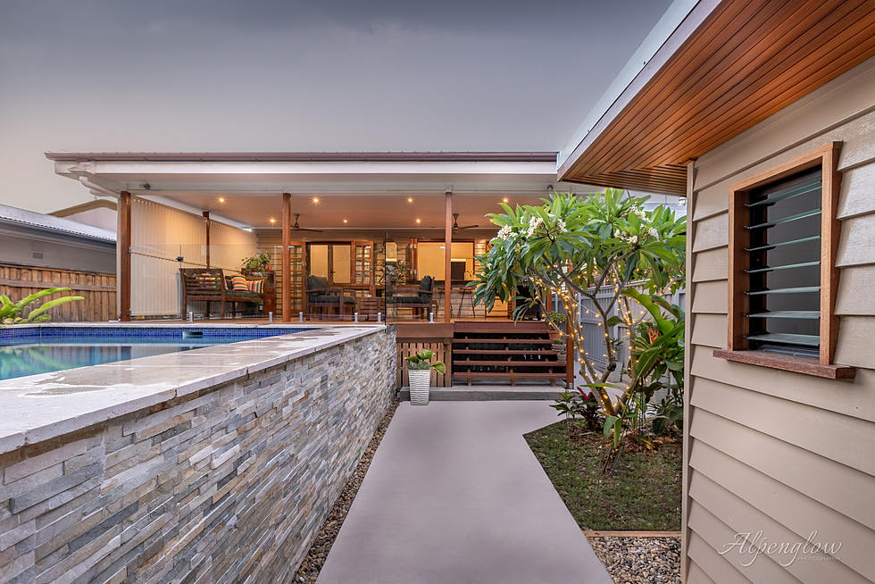 Dusk skies frame this Queensland pool and house