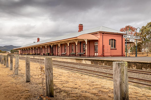 Old Queensland country town railway station under brooding skies
