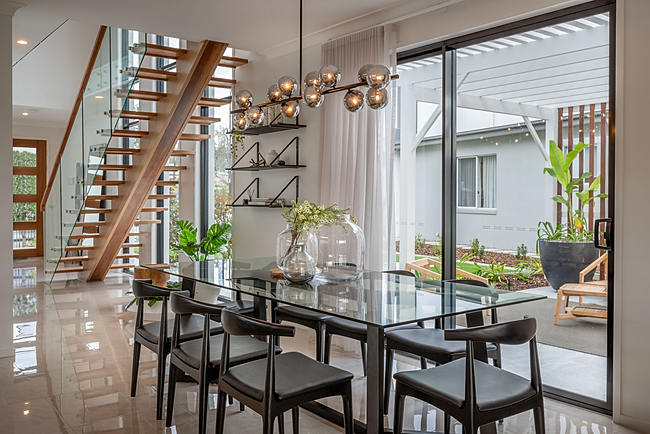 Unique lighting and open plan interior design make a stylish dining room