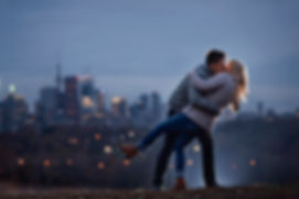 Engagement Photos of women and man backlit