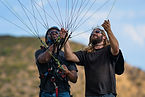 Student learning to kite a paraglider with instructor supervision. One on one paragliding course, paragliding lessons, paragliding california