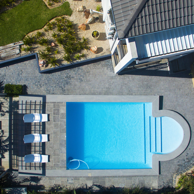 Our poolside and articulated gardens.