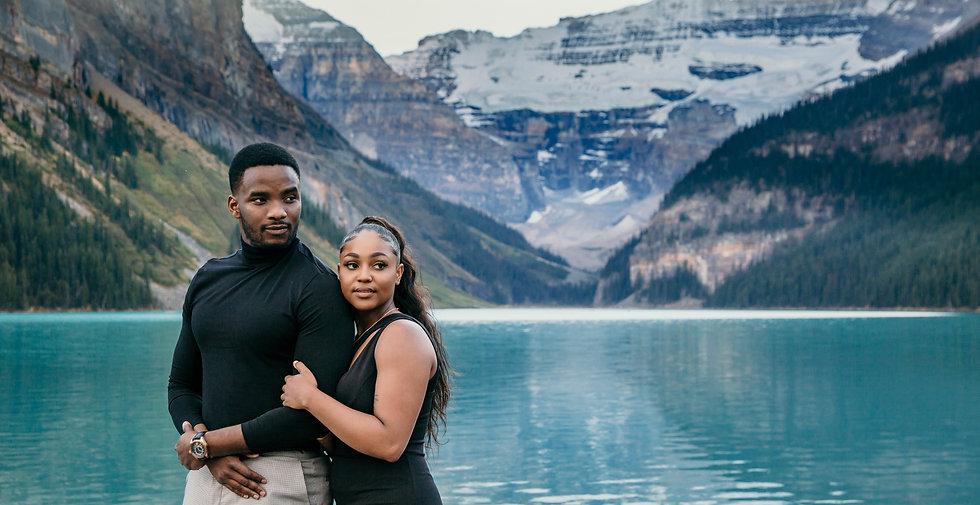 Photo of couple at lake Louise lake side.
