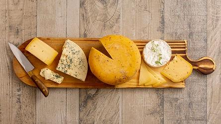 vista-superior-varios-quesos-mesa_23-214