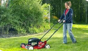 volunteer mowing lawn
