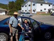 Volunteer driver taking neighbor to senior dining