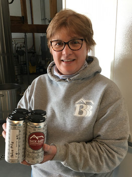 Owner holding 1st Small Batch Cans