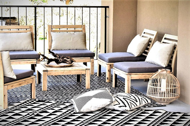 Outdoor terrace furnished in bohostyle with natural materials and earthy tones