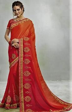 Pink and Orange Crepe Silk Saree with golden embroidery and stitched blouse.