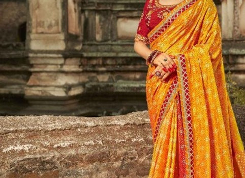 Orange printed crepe saree with stitched blouse and petticoat