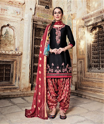 Black embroidered shirt and red printed salwar