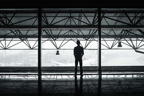 silhouette-silhouette-of-man-standing-be