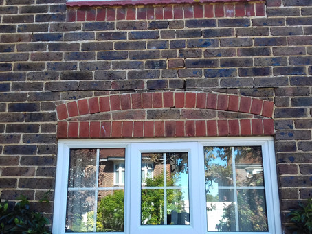 Installation of new lintel below curved arch