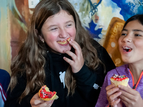 Eating pizza icing cupcakes.