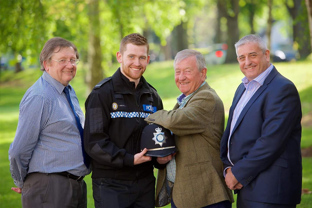 Uniformed Adam McWalter along with his father, grandfather and uncle - all former policemen