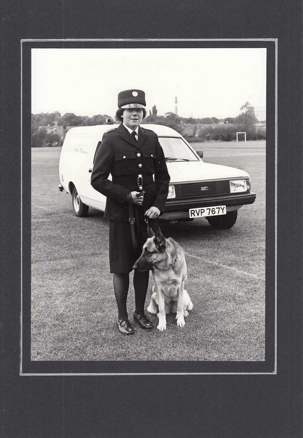 Jean in uniform with a German Shepherd police dog