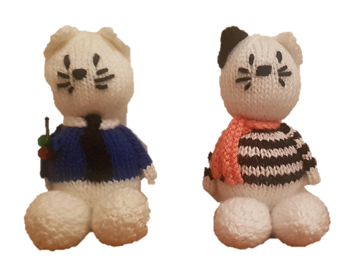 Knitted cat cop and robber set