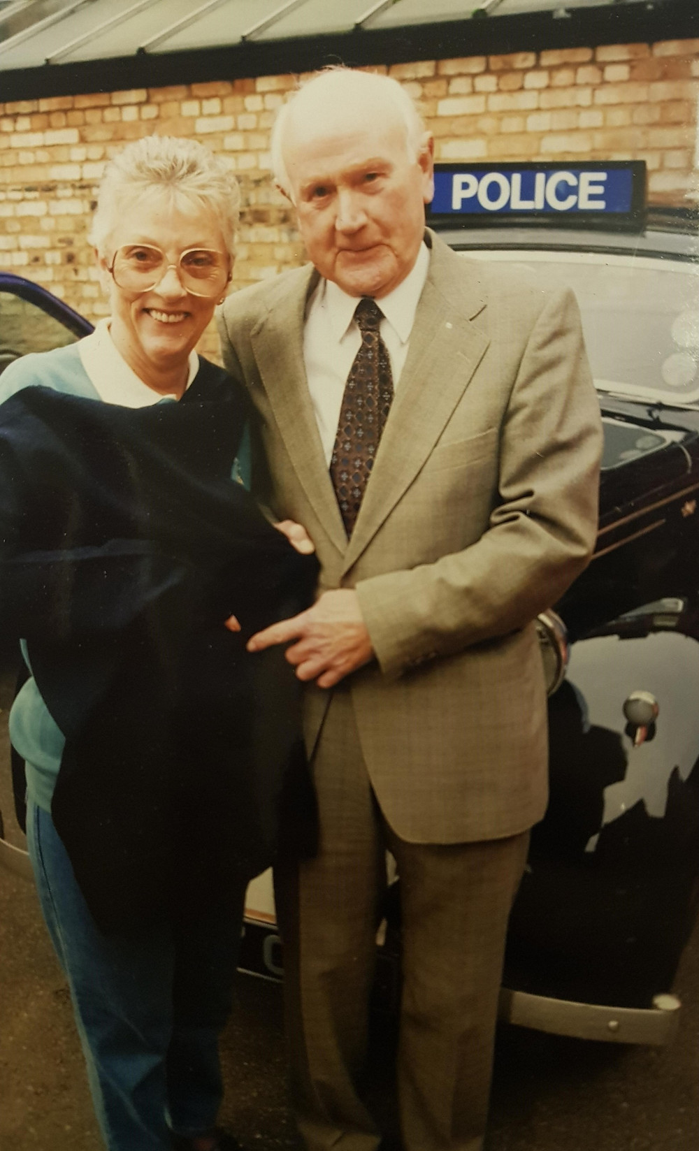 Retired Inspector Somerville and his wife Doreen handing over the jumper to WMP Museum at Sparkhill in 1998