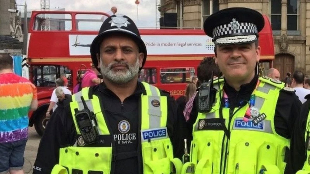 Special Constable Resham Nahal alongside Chief Constable Dave Thompson in uniform at Birmingham's Pride event in 2019