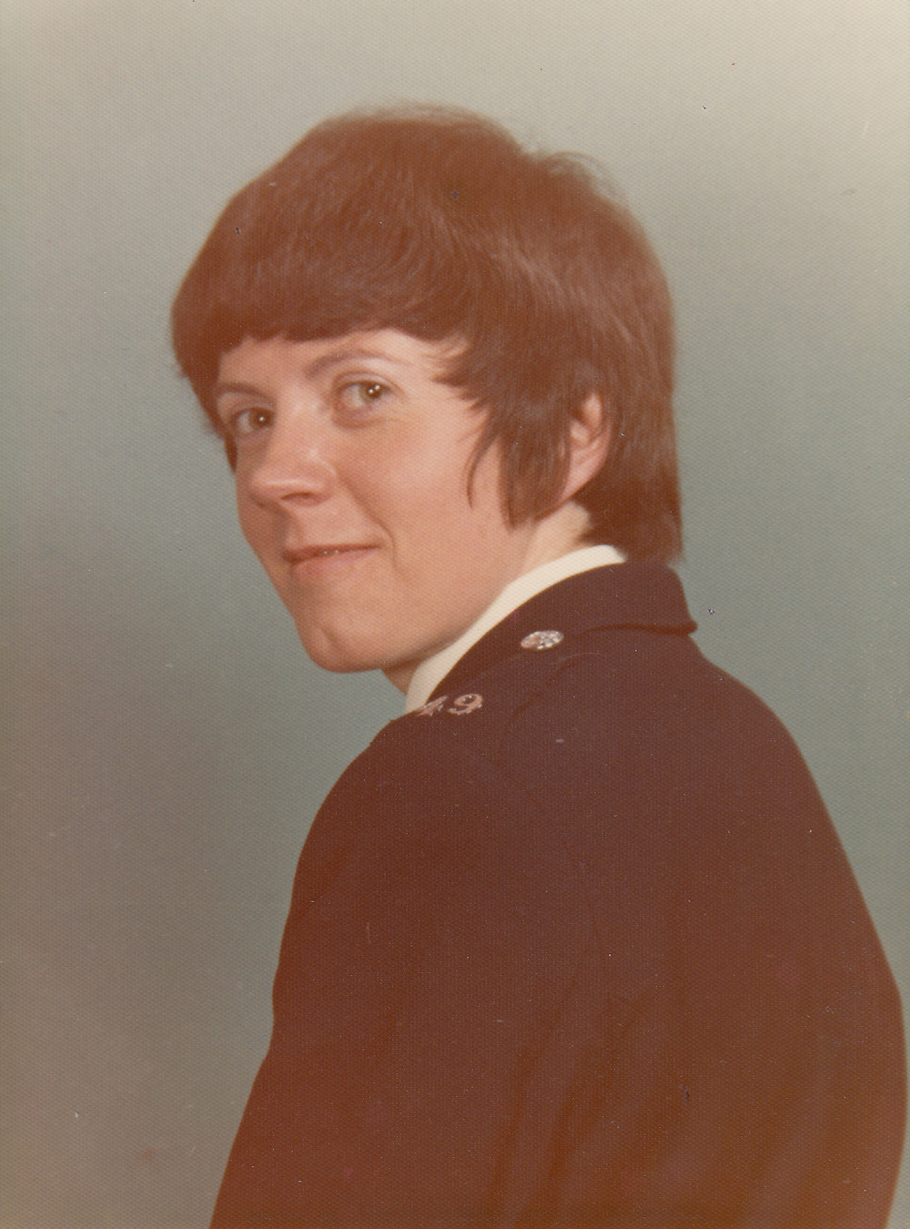 Jean in uniform, collar number 49 is visible on her shoulder