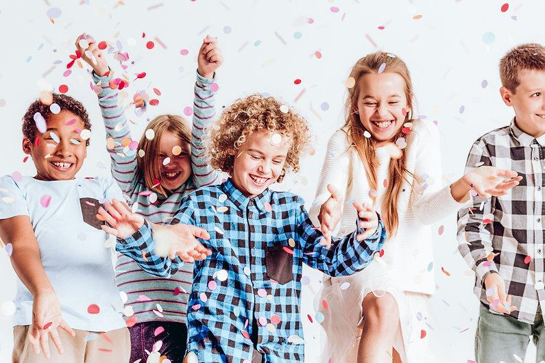 kids-with-confetti-P6X6ZVA.jpg