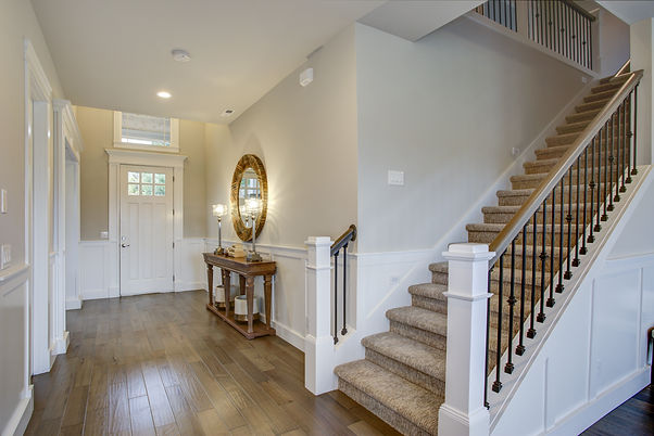 Fabulous foyer features staircase wall a