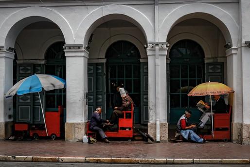 Men getting their shoes shined in Ecuador