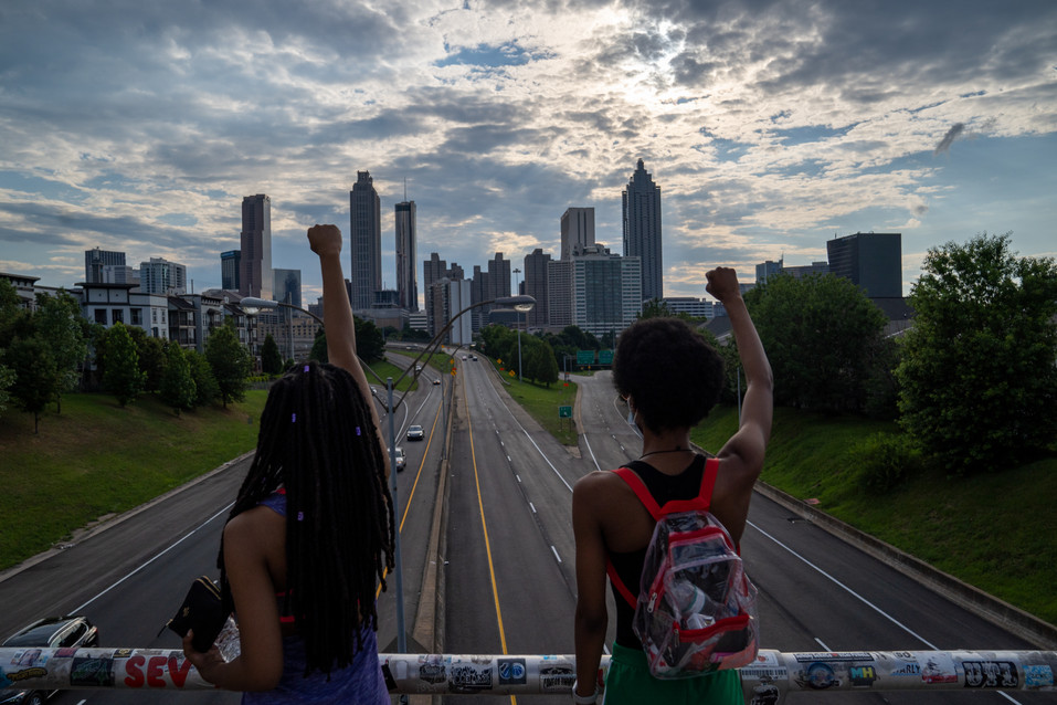 Protestors looking over the Jackson Street bridge at the Atlanta skyline June 19, 2020