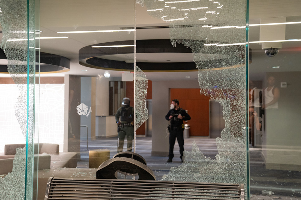 Officers inside the Omni, behind broken glass. May 30, 2020