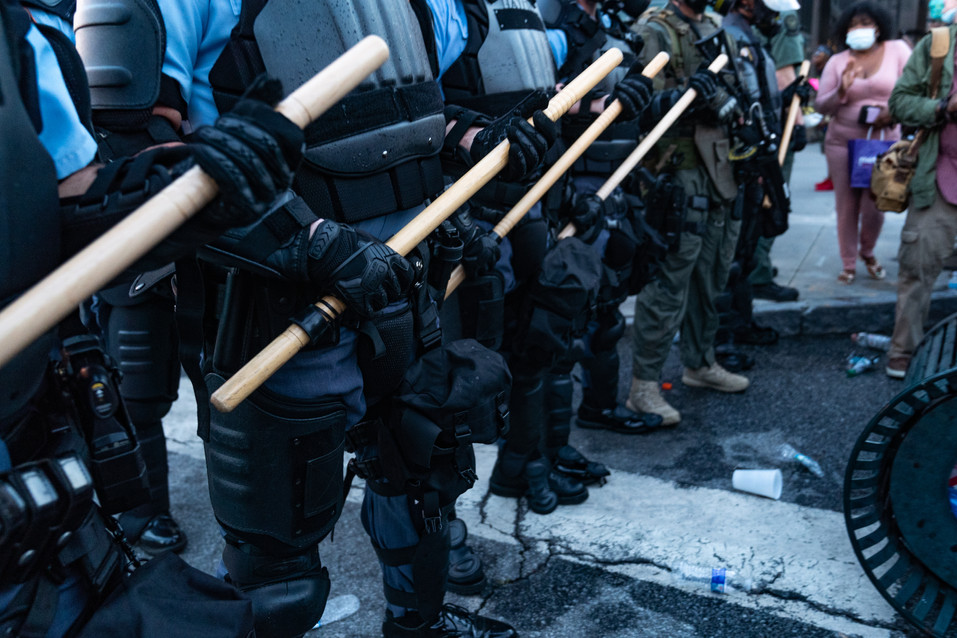 Officers holding wooden batons on the front lines of the protest May 30, 2020