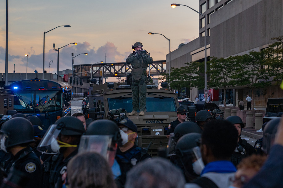 A SWAT officer stands on top of an armoured car. May 30, 2020