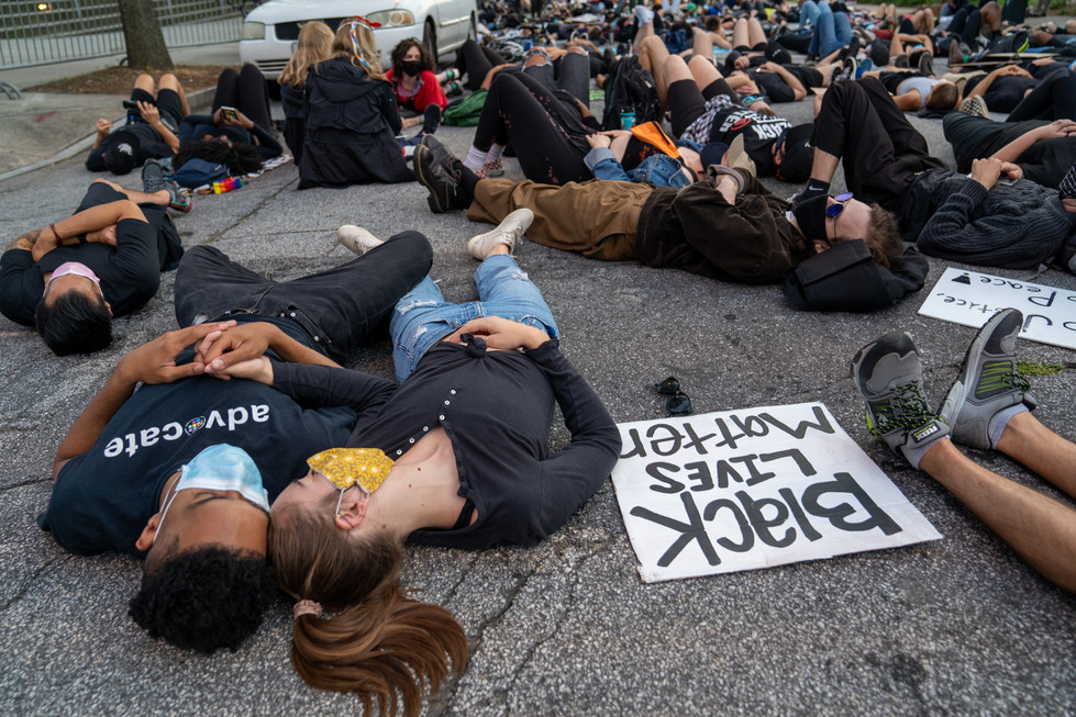 "Protestors participating in the ""Die-in"" outside of one of Atlanta's precincts"