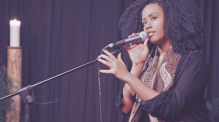 African American woman on microphone