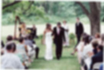 Outdoor ceremony under the tree at Birch Manor