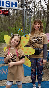 Photograph by Tina Spencer, titled Mother Daughter Flower Butterfly 5k-10k 2015