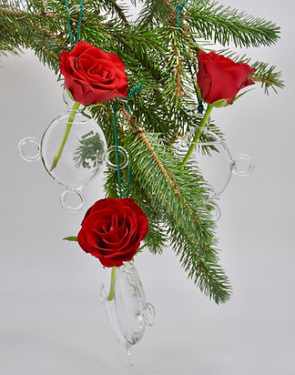 Roses on a branch in tree vases