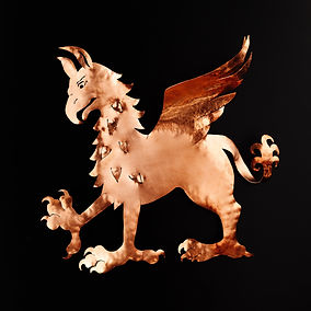 hand wrought copper griffin tree topper