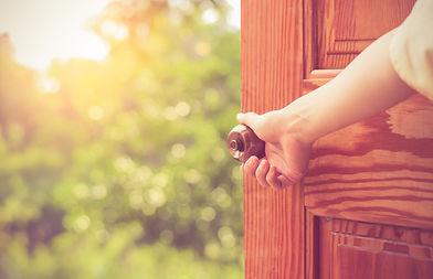 Women hand open door knob or opening the