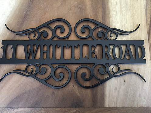 Decorative scroll house sign