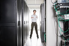 a-male-computer-technician-standing-in-a