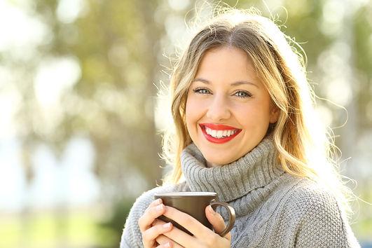 Happy woman wearing a grey jersey lookin