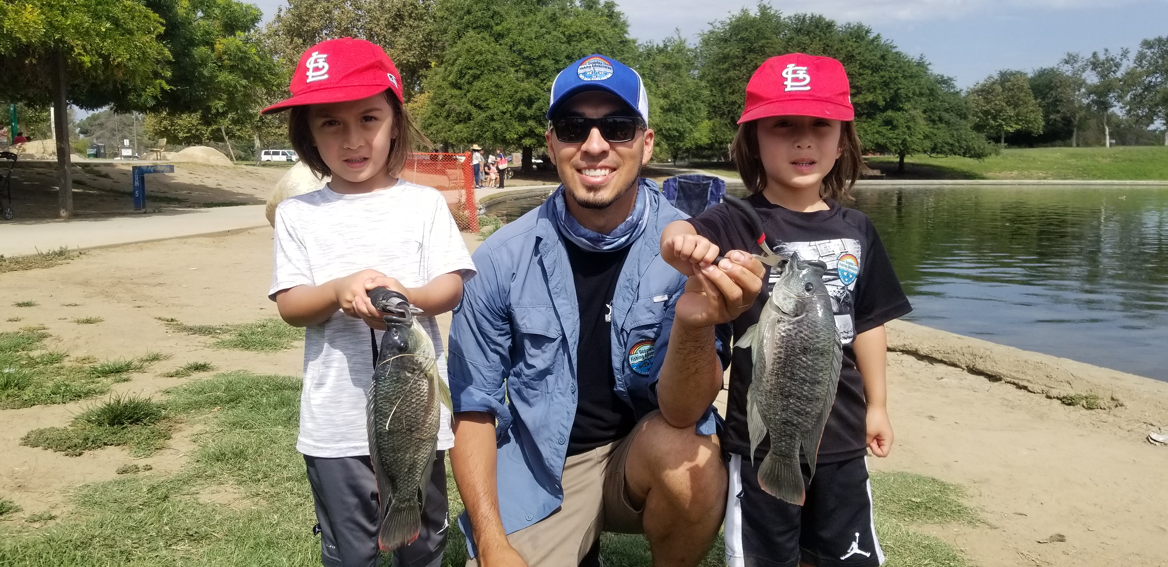 twin boys catch twin fish