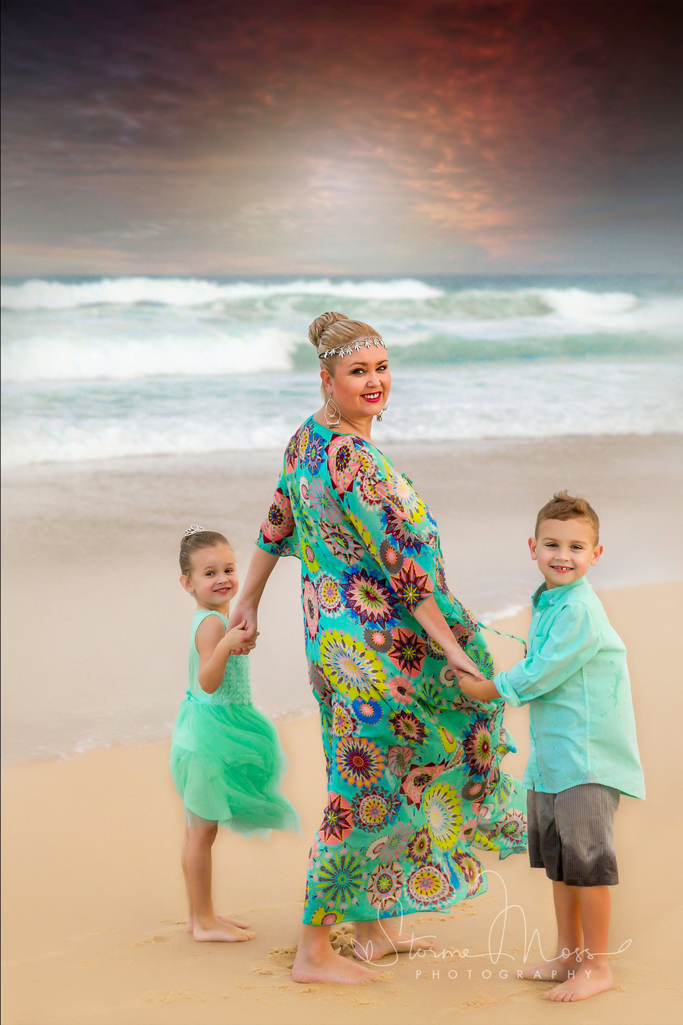 Mother and children on beach family photo shoot