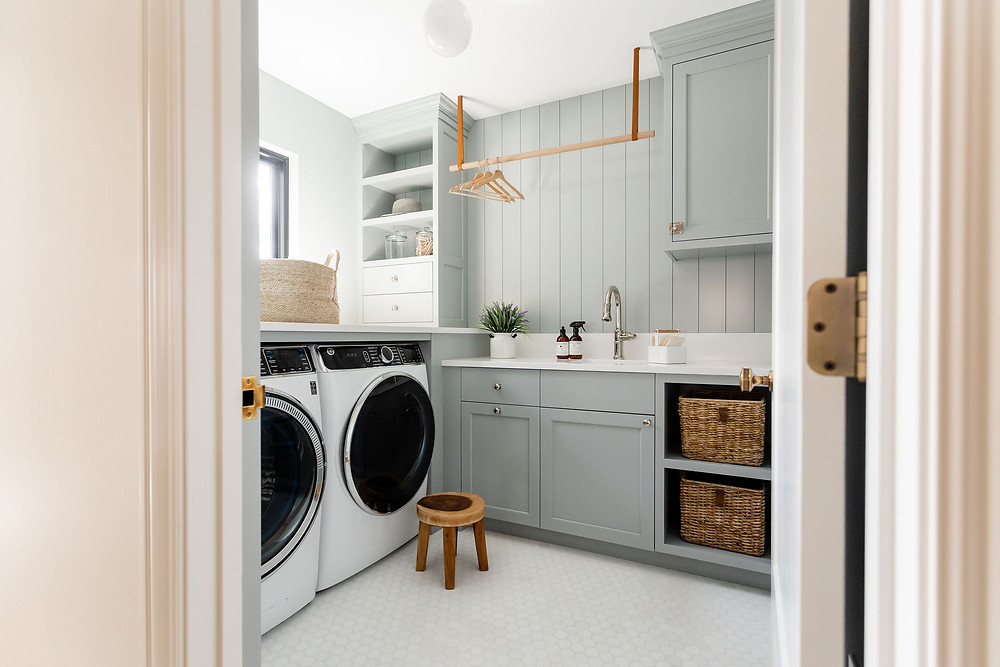 Tone on tone laundry room featuring booth bay gray by Benjamin Moore, white Thassos stone hexagon floor tile.